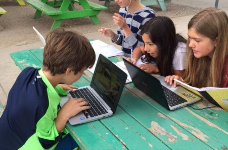 Middle School Students Learning with ChromeBooks in their Outdoors Classroom!